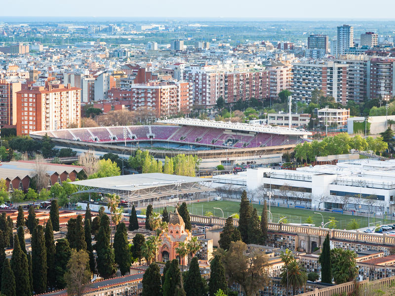 Barcelona cityscape with camp nou stadium. And cemetery in evening stock photography