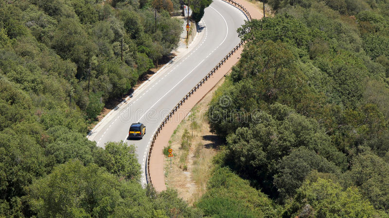 Barcelona curvy road. Curve of a hilly road in Barcelona, Catalonia, Spain, July 2016 royalty free stock photo