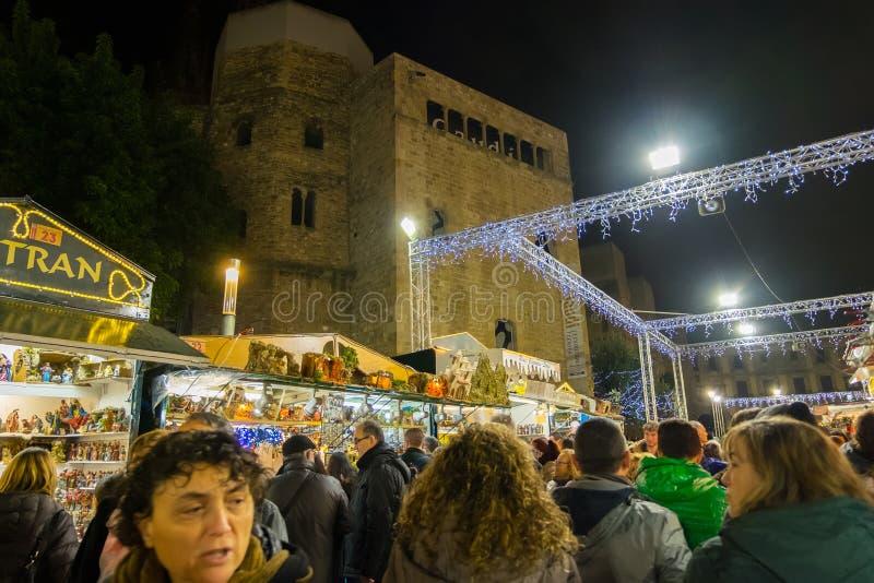 Santa Llucia christmas market at night in Barcelona, Catalonia, Spain.Santa Llucia christmas market at. Santa Llucia christmas market photo at night in Barcelona royalty free stock photo