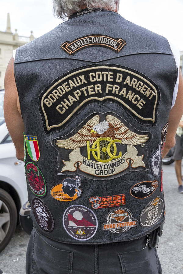 BARCELONA HARLEY DAYS 2012. BARCELONA, SPAIN - JULY 08: Unidentified persons with typical biker jacket a Harley Davidson motorbike at an exhibition during stock photos