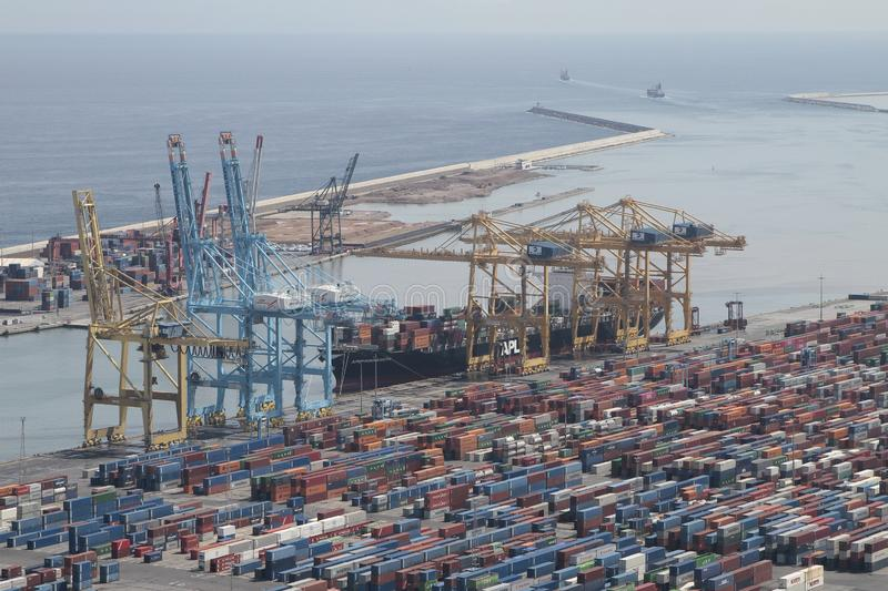 Barcelona industrial harbor with cranes, containers and cargo royalty free stock image
