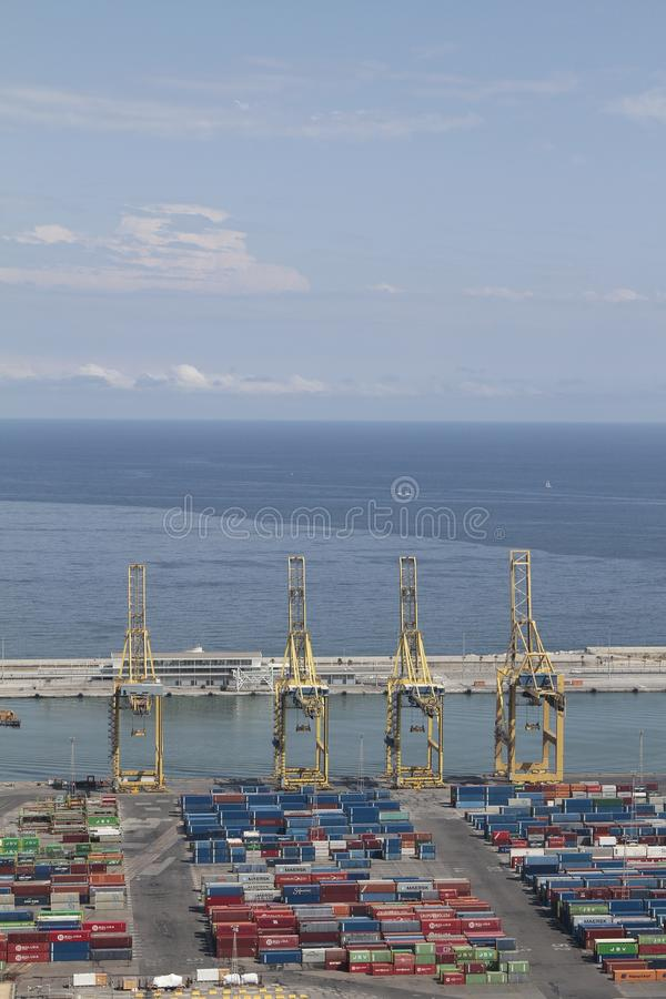 Barcelona industrial harbor with cranes and containers royalty free stock photos