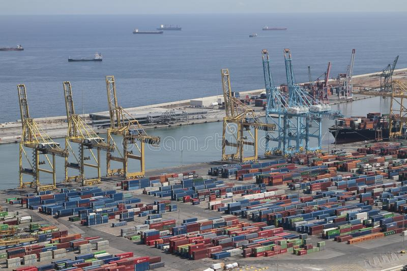 Barcelona industrial harbor with cranes and freight containers stock photography