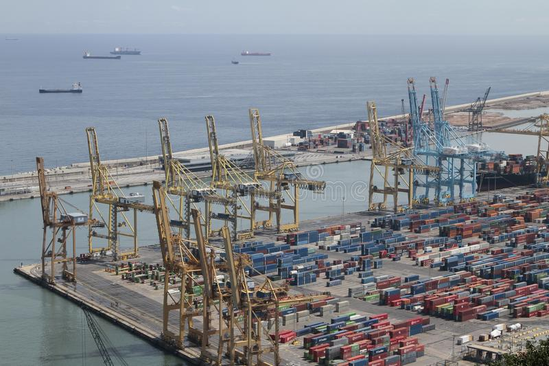 Barcelona industrial harbour with cranes and containers stock photo
