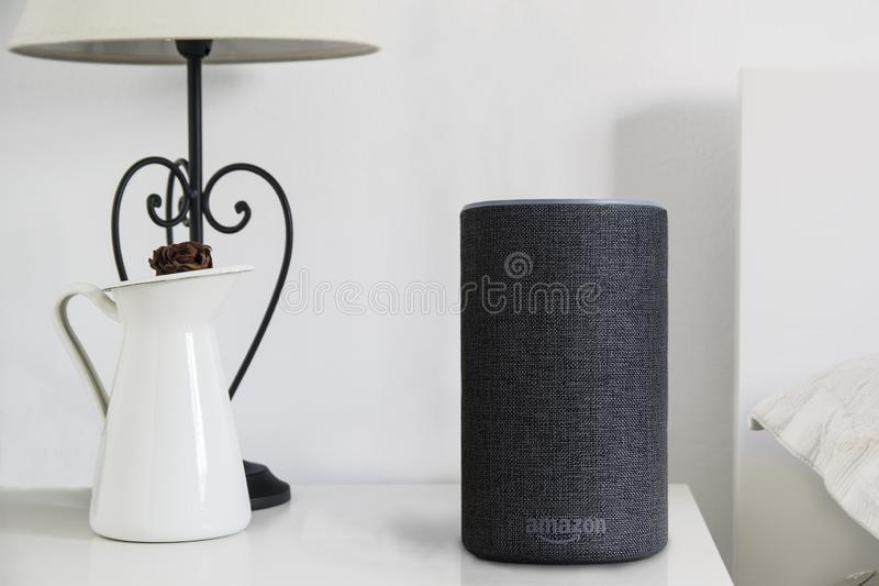 BARCELONA - JANUARY 2019: Amazon Alexa Smart speaker on a book on a bedroom table stock images