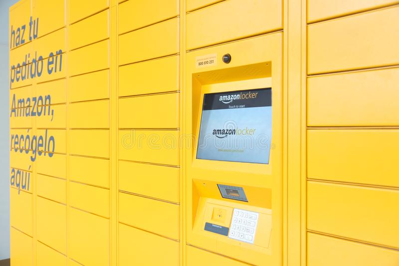 BARCELONA, JULY 2, 2019: Amazon Locker pick up station and the screen with the logo in Barcelona, Catalonia. royalty free stock image