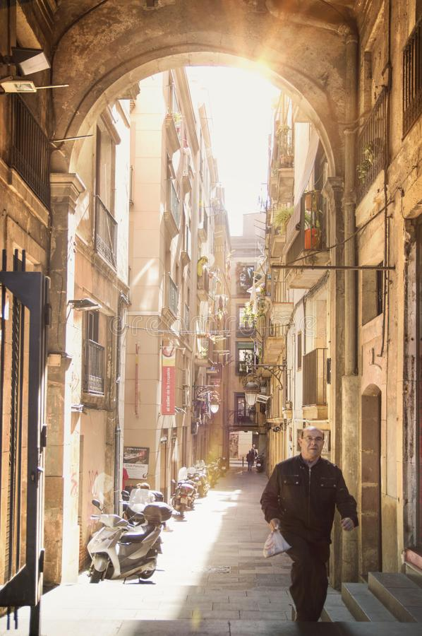 BARCELONA, MARCH 31: Labyrinthine narrow street in the old town Gothic Quarter in Barcelona royalty free stock image