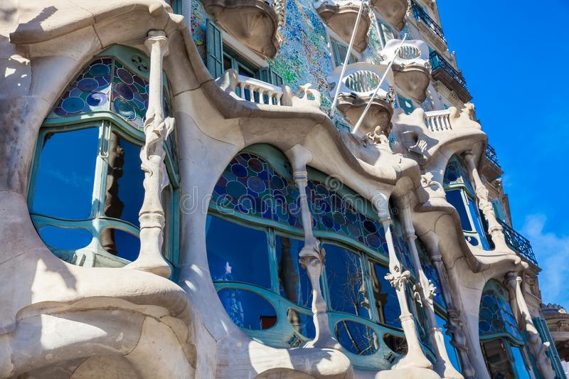 Woman at a window of the Gaudi design designed Casa Batllo in Barcelona Spain. BARCELONA - MARCH, 2018: Woman at a window of the Gaudi designed Casa Batllo in royalty free stock images