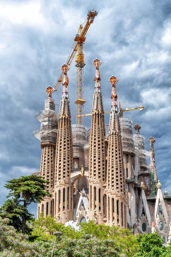 BARCELONA - MAY 14, 2018: Sagrada Famila facade on a cloudy day. stock photo