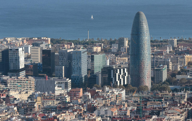 Barcelona north seaside skyline with Agbar Tower rounded skyscrapper on main term. The city of Barcelona, skyline view from nearby hill of Turo de la Rovira stock image