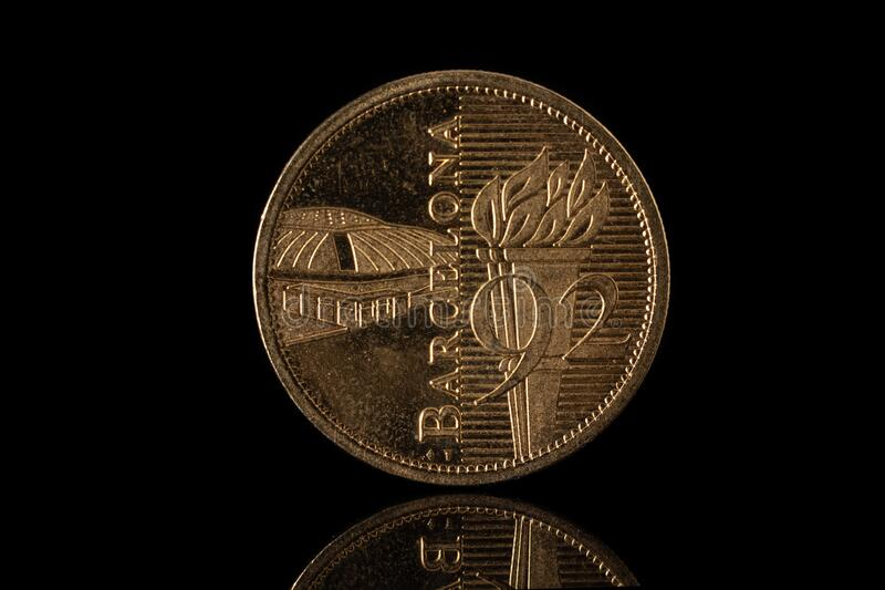Barcelona 1992 olympics commemorative coin isolated on black.  royalty free stock image