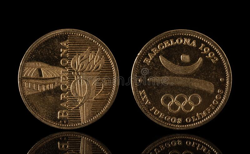 Barcelona 1992 olympics commemorative coin isolated on black, both sides.  royalty free stock photography