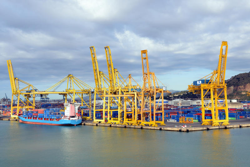 Barcelona port. BARCELONA, SPAIN- JULY 16:A container ship are standing in Barcelona port on July 16,2012. It is Catalonia's largest port with a trade volume of royalty free stock photo