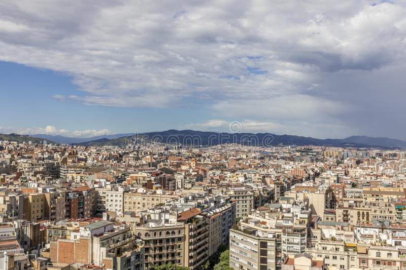Barcelona skyline with dark clouds coming. Barcelona skyline with hills and dark clouds coming from the right royalty free stock photos