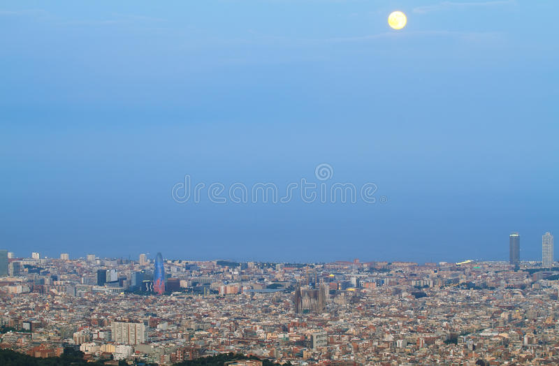 Barcelona skyline at dusk. With Agbar tower and Sagrada Familia standing out stock photo