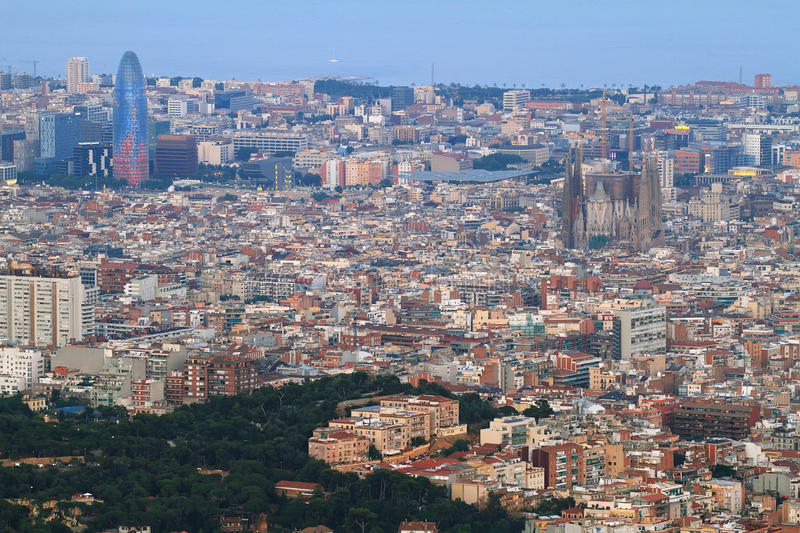 Barcelona skyline at dusk. With Agbar tower and Sagrada Familia standing out stock photos