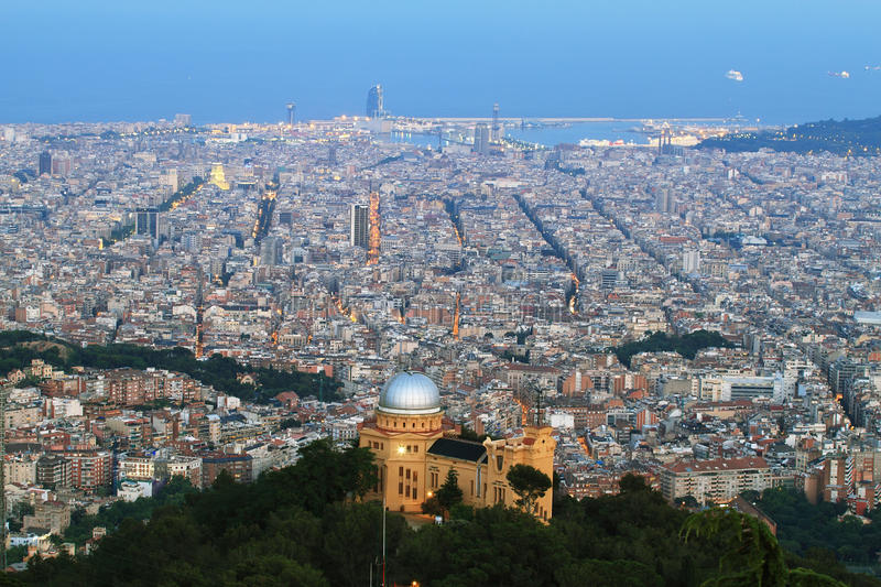 Barcelona skyline at dusk. With Fabra observatory at foreground and harbor at background stock photos