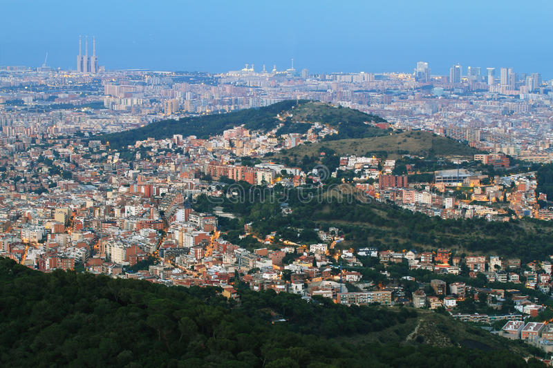 Barcelona skyline at dusk. With mountain of Carmel in the middle and three chimneys of thermal power station in the left stock images