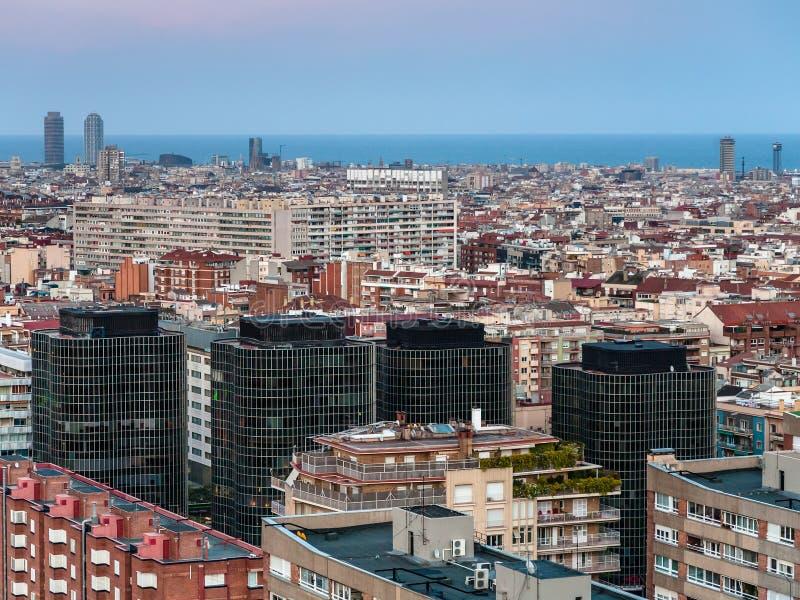 Barcelona skyline in evening gloaming. Barcelona city skyline in evening gloaming in spring royalty free stock photos