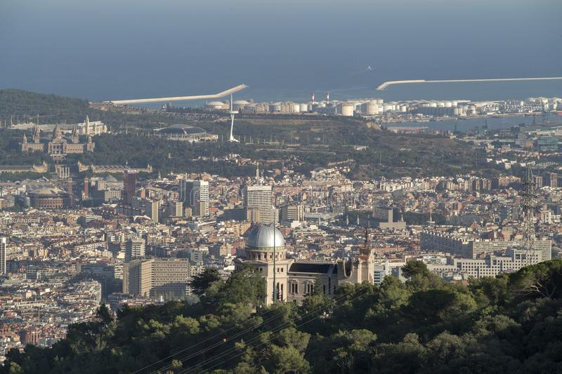 Barcelona skyline and industrial port. Barcelona city skyline in the afternoon with beautiful light stock photography