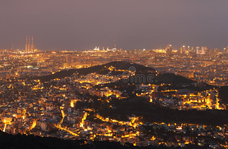 Barcelona skyline at night. With mountain of Carmel in the middle and three chimneys of thermal power station in the left royalty free stock photography