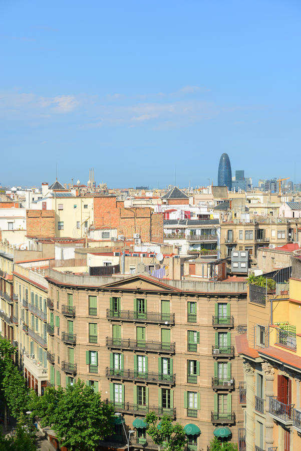 Barcelona skyline and Torre Agbar, Spain. Barcelona skyline and Torre Agbar from the top of Casa Mila in Eixample District of Barcelona, Catalonia, Spain. Torre stock images