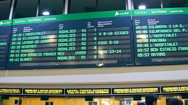 BARCELONA, SPAIN - APRIL, 15, 2017. Electronic departure board above ticket office at railroad terminal royalty free stock images