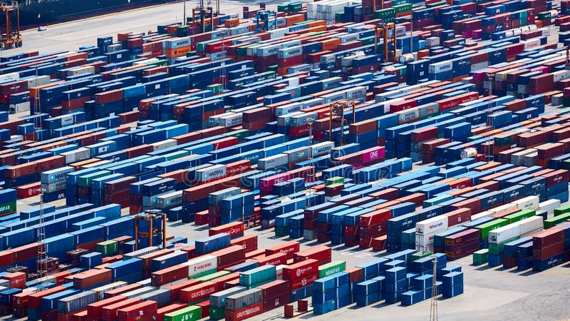 Barcelona, Spain - April 8, 2019: Industrial Port for freight transport and global business. Containers awaiting. Shipment royalty free stock images