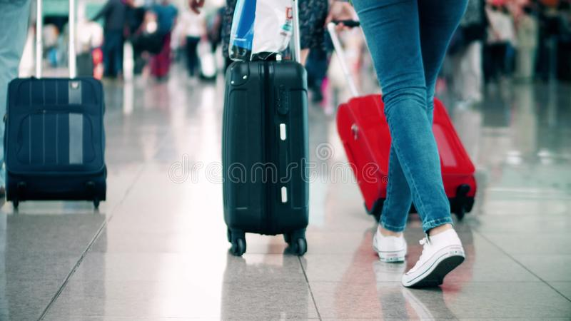 BARCELONA, SPAIN - APRIL, 15, 2017. Steadicam close-up shot of tourist feet and baggage at international airport stock image