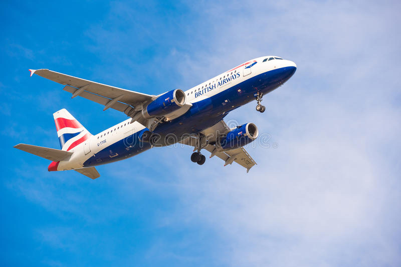 BARCELONA, SPAIN - AUGUST 20, 2016: British Airways plane in the blue sky. Copy space for text. royalty free stock photography