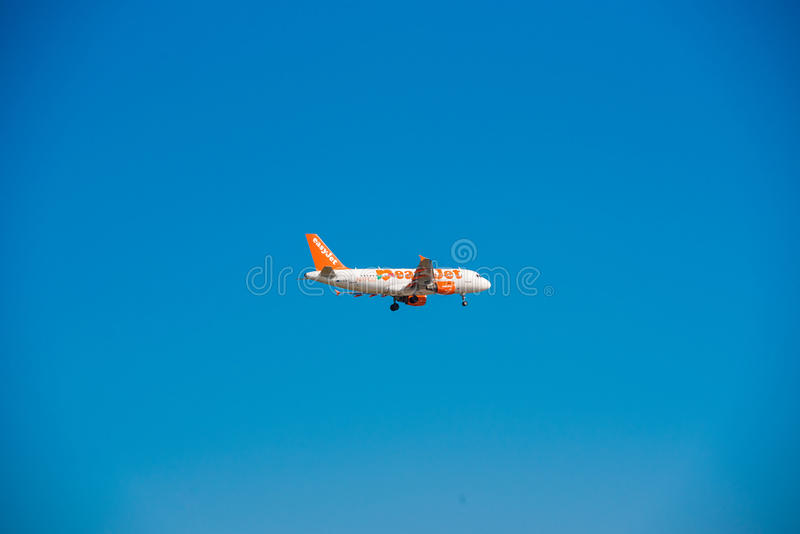 BARCELONA, SPAIN - AUGUST 20, 2016: Easyjet airplane in the sky. Copy space for text. royalty free stock photo