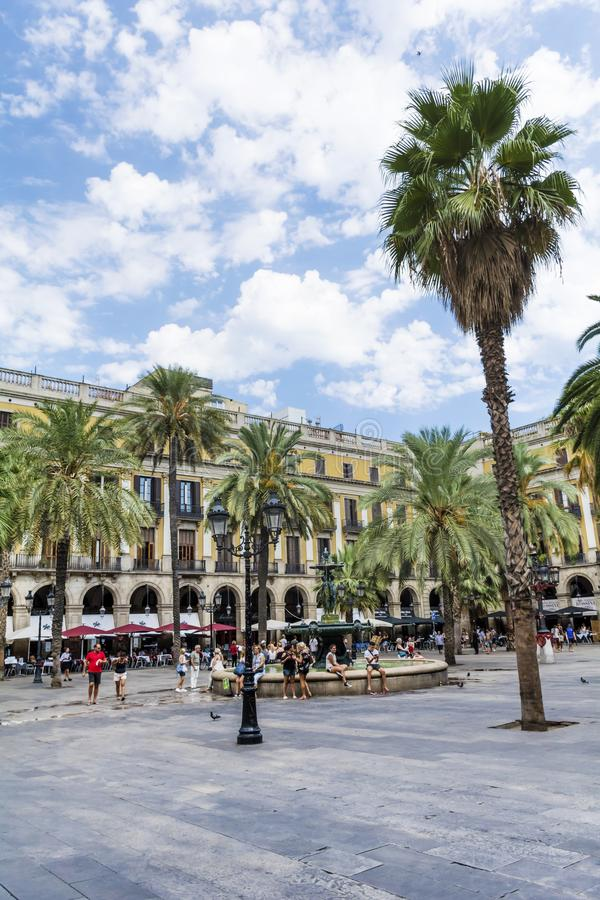 Place Royale in Barcelona,Spain. Barcelona, Spain - August 15, 2017 - fountain and palms in the Place Royale royalty free stock photos