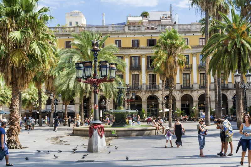 Place Royale in Barcelona,Spain. Barcelona, Spain - August 15, 2017 - fountain and palms in the Place Royale square royalty free stock image