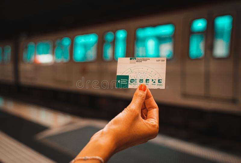 Barcelona, Spain. August 2019: Hand with Public transport card T10 of Barcelona. stock photo