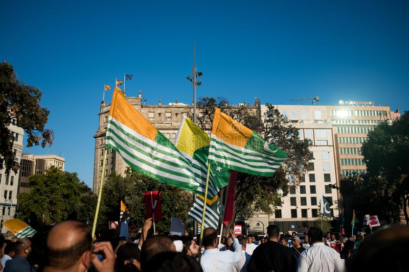 Barcelona, Spain - 10 august 2019: Kashmiri flags during protest and demonstratio against indian government revoke of autonomous royalty free stock photography
