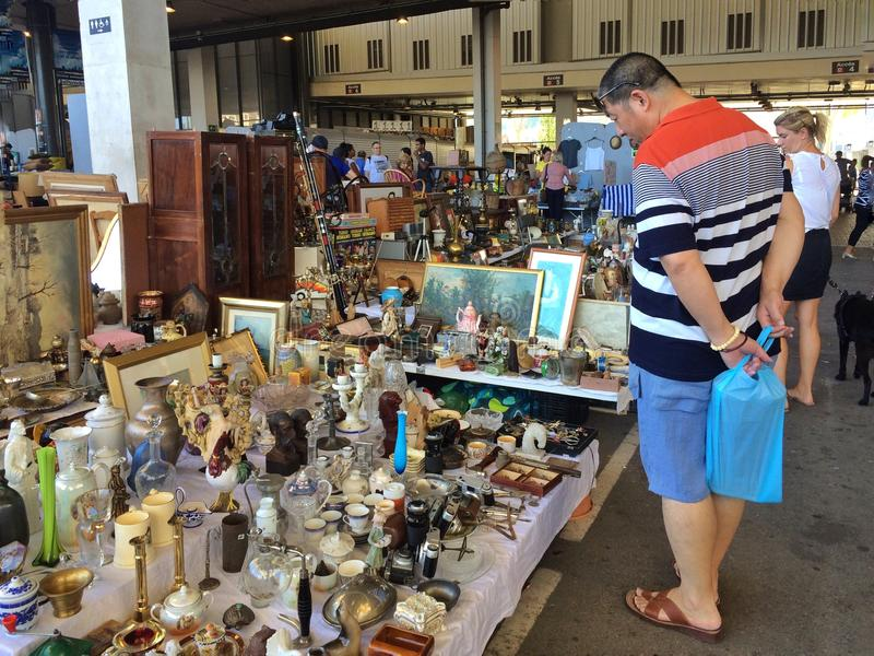 Barcelona, Spain - August 21, 2016: Visitors inspect examine various range of retro goods merchandise on flea market stock photography