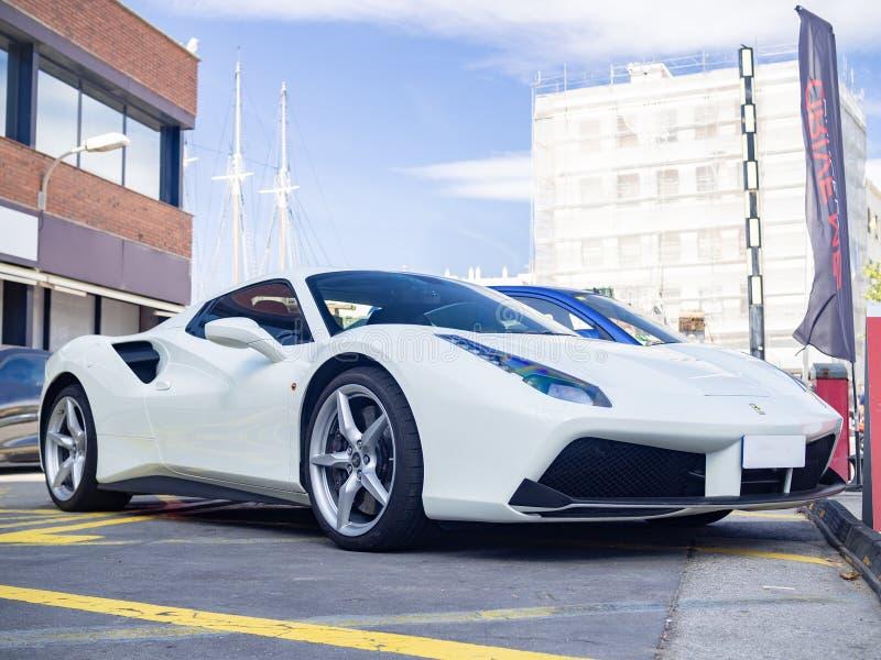 White Ferrari 488 Spider. BARCELONA, SPAIN-AUGUST 14, 2019: White Ferrari 488 Spider at city streets stock photography