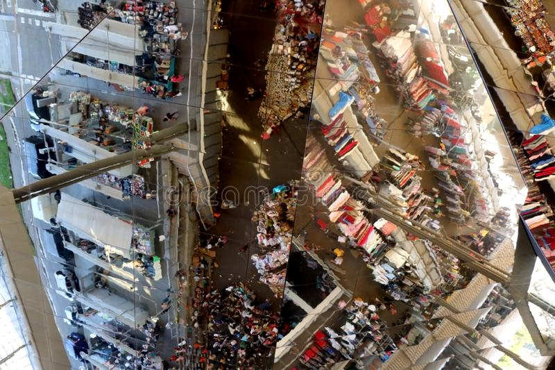 Barcelona, Spain. July 7, 2018: Reflection of visitors and antiques on the reflective roof of Mercat dels Encants, flea market in stock photography
