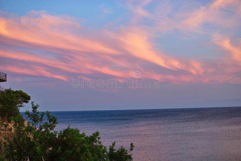 Barcelona, Spain - 18.08.2019: Beautiful sunset on the spanish coast of Costa Brava. Skyline, sunny, panorama, summer, tourism, cloud, sunshine, wave, sea royalty free stock photo