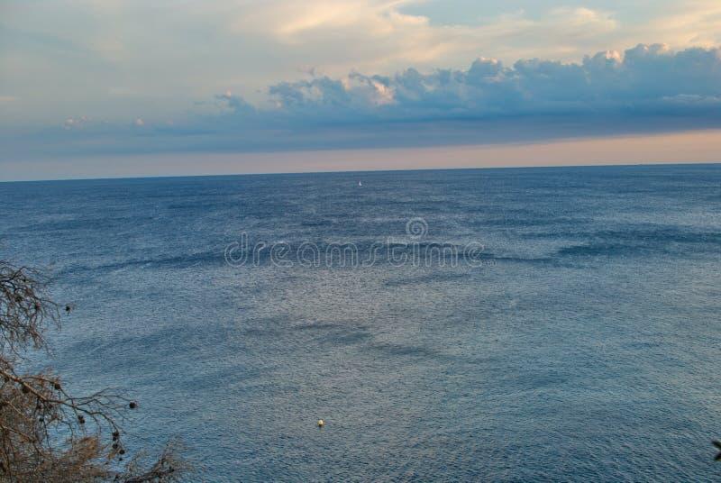 Barcelona, Spain - 18.08.2019: Beautiful sunset on the spanish coast of Costa Brava. Skyline, sunny, panorama, summer, tourism, cloud, sunshine, wave, sea stock photos