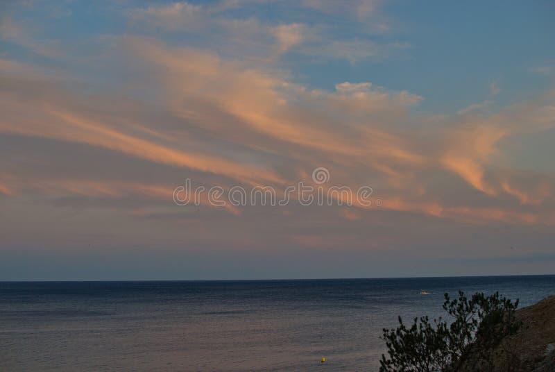 Barcelona, Spain - 18.08.2019: Beautiful sunset on the spanish coast of Costa Brava. Skyline, sunny, panorama, summer, tourism, cloud, sunshine, wave, sea stock image