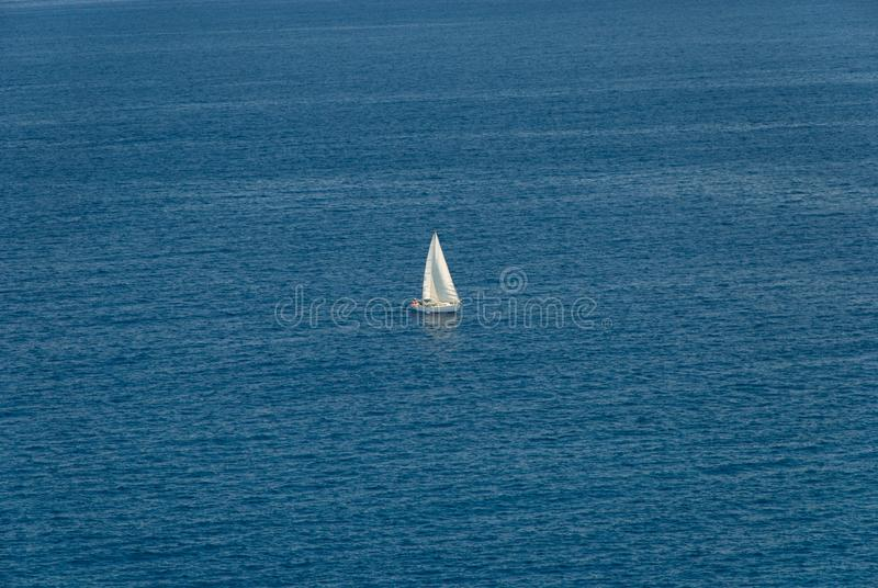 Barcelona, Spain - 18.08.2019: Beautiful white sailing yacht in the blue huge sea. Sun, regatta, cruise, lonely, outdoor, freedom, speed, marine, sunny, view stock photos