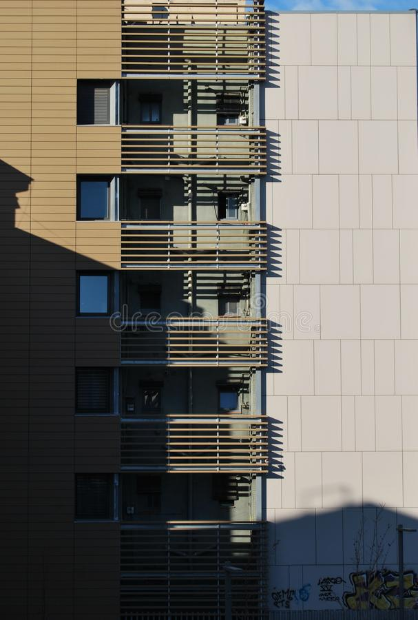 BARCELONA, SPAIN - DECEMBER 2017: Balconies and geometrical lines casting shadows royalty free stock image