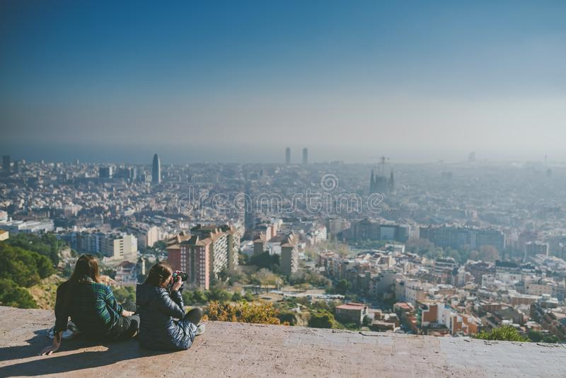 Viw from Bunkers del Carmel panorama, Barcelona. BARCELONA, SPAIN - DECEMBER 26, 2015: People watching panorama of Barcelona form the hill known as the `Turo de stock images