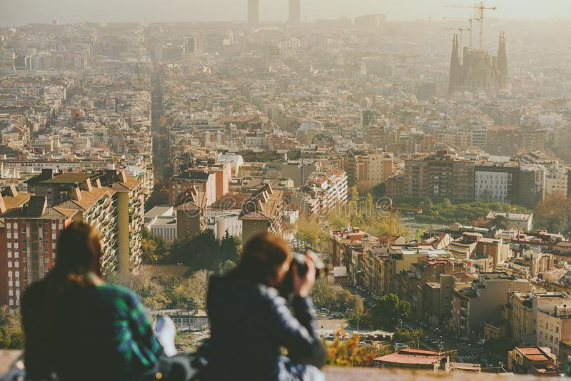 Viw from Bunkers del Carmel panorama, Barcelona. BARCELONA, SPAIN - DECEMBER 26, 2015: People watching panorama of Barcelona form the hill known as the Turo de royalty free stock photography