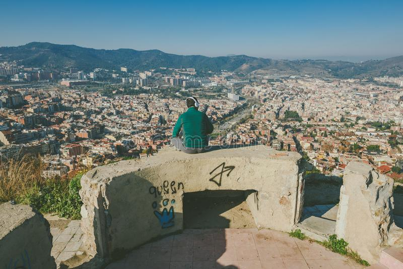 Viw from Bunkers del Carmel panorama, Barcelona. BARCELONA, SPAIN - DECEMBER 26, 2015: People watching panorama of Barcelona form the hill known as the Turo de royalty free stock photos