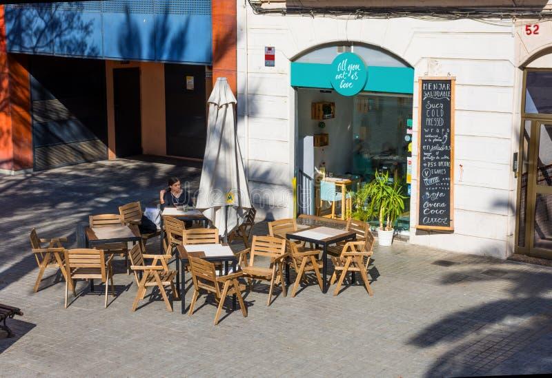 BARCELONA, SPAIN -  FEBRUARY 23, 2019: Cafe summer terrace in Barcelona, Spain. Cozy city terrace stock image