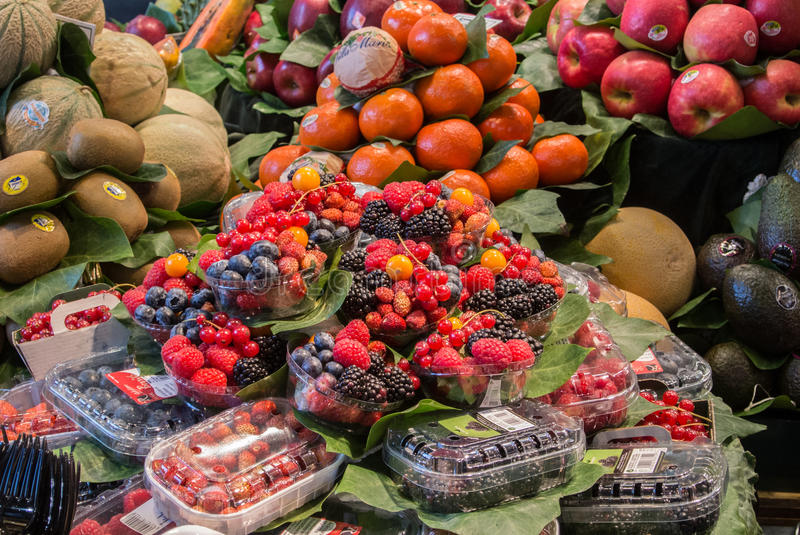 BARCELONA, SPAIN - FEBRUARY 12, 2014: Fruits and berries at La Boqueria food market. At the center of Barcelona, Spain stock image