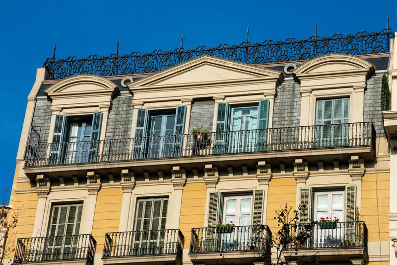 Old building facade and balconies on Passeig de Gracia Avenue. Barcelona, Spain. February 9, 2019. Old building facade and balconies on Passeig de Gracia Avenue stock photos
