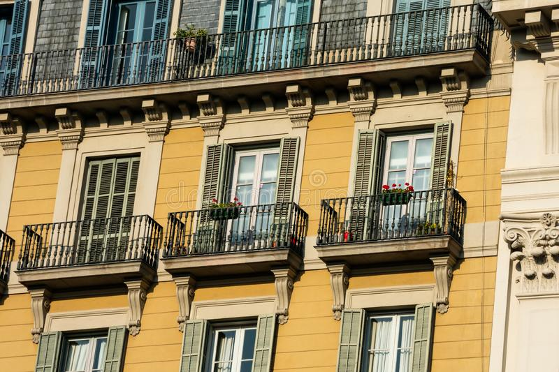 Old building facade and balconies on Passeig de Gracia Avenue. Barcelona, Spain. February 9, 2019. Old building facade and balconies on Passeig de Gracia Avenue royalty free stock photos